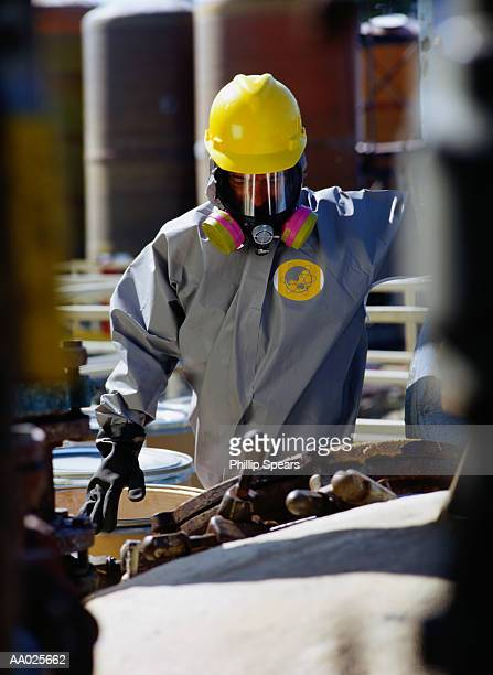 Maintenance Engineer Inspecting Equipment