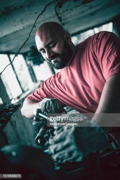 Maintenance Engineer Repairing Factory Machine