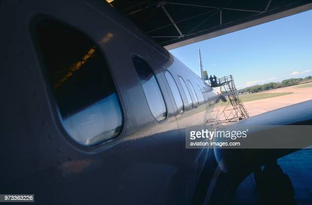 maintenance in a hangar with engineers inspecting the tail of a LAPA Boeing 757200