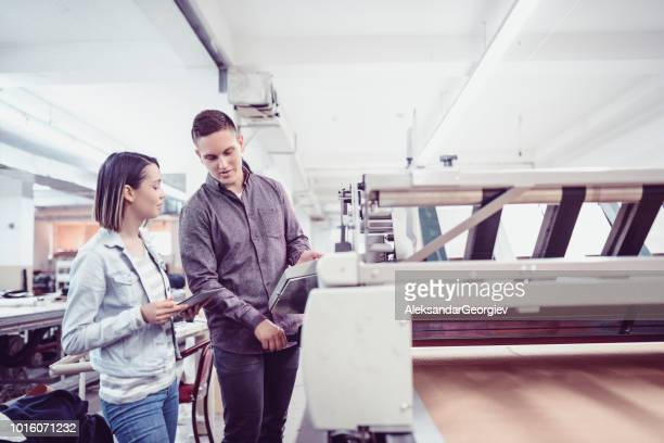 Maintenance Inspector Showing Owner That The Machine Is Fixed