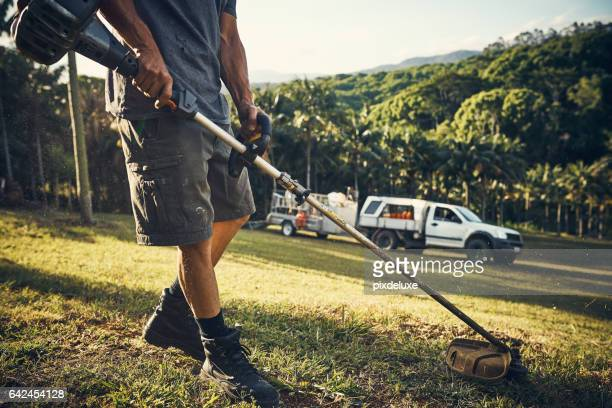maintenance is his game - lawn stock pictures, royalty-free photos & images