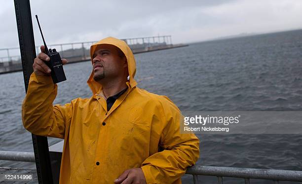 A maintenance man at One Brooklyn Bridge Plaza apartments Albert Macho monitors open windows in the building along the East River shore August 28...