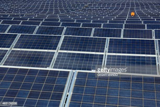 TOPSHOT A maintenance man works on solar panels at Norsol solar energy company in Villaldemiro northern Spain on February 10 2015 AFP PHOTO/ CESAR...
