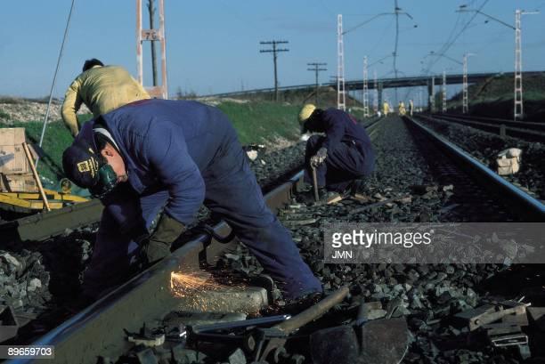 Maintenance of a railroad Workers fix the railroad in Alcazar de San Juan Ciudad Real province
