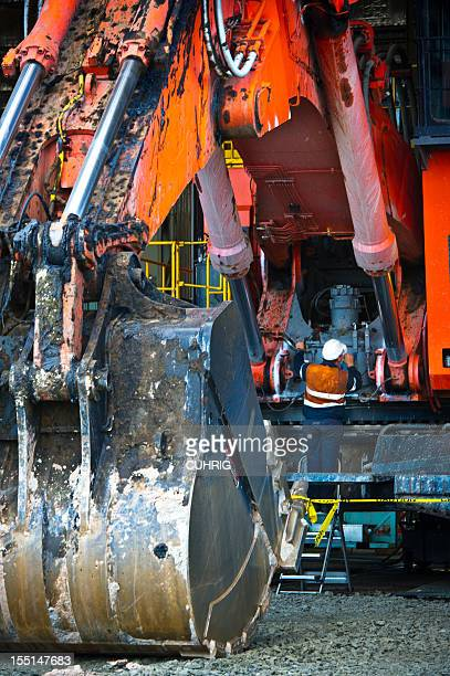 Maintenance on Excavator