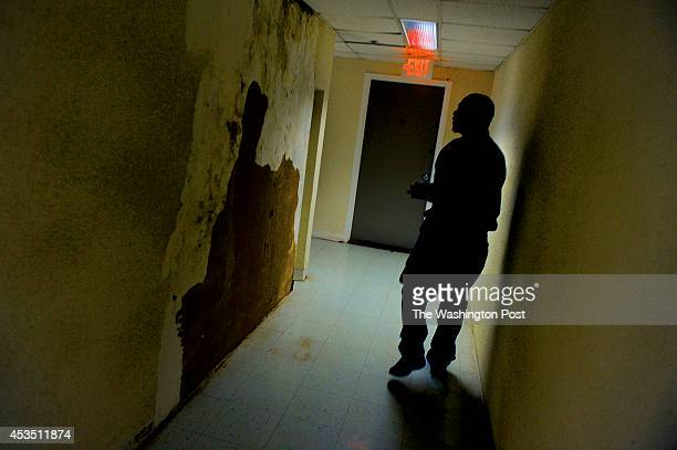 Maintenance supervisor Mark Hanson in a hallway that has mold on the walls as well as damaged wallpaper The Park Southern Towers has many...