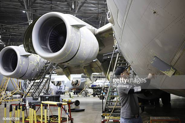 A maintenance technician inspects a US Air Force Boeing C17 Globemaster III airplane at the Boeing Co Global Services and Support facility in San...