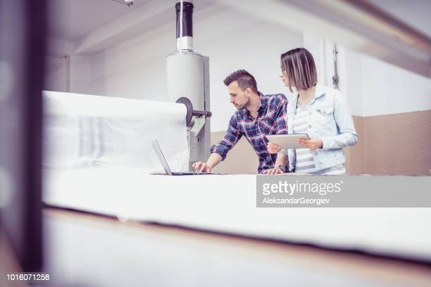 Maintenance Technician Programming Machine With Quality Control Inspector