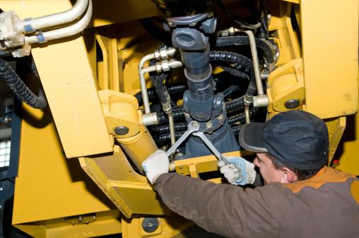 maintenance work of heavy loader 119491874