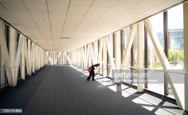 A maintenance worker dusted in a deserted skyway over 3rd Ave S Tuesday afternoon With downtown Minneapolis buildings largely empty so are the...