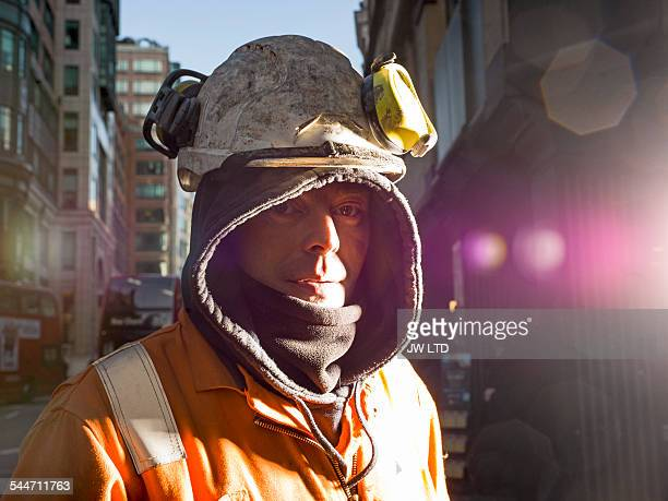 maintenance worker looking to camera, City street