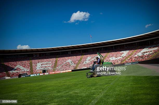 A maintenance worker prepares the pitch at the Red Star Belgrade Marakana stadium on April 27 25 years after the Red Star Belgrade European Cup final...