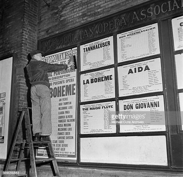 A maintenance worker puts up flyers at the Metropolitan Opera House in New York New York
