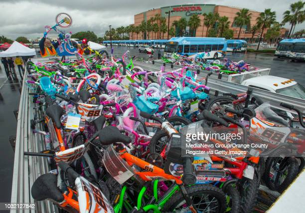 OCTA maintenance worker Todd Fairbanks loads up some of the 250 bicycles donated by Pancho's Restaurant during StuffABus in Anaheim California...