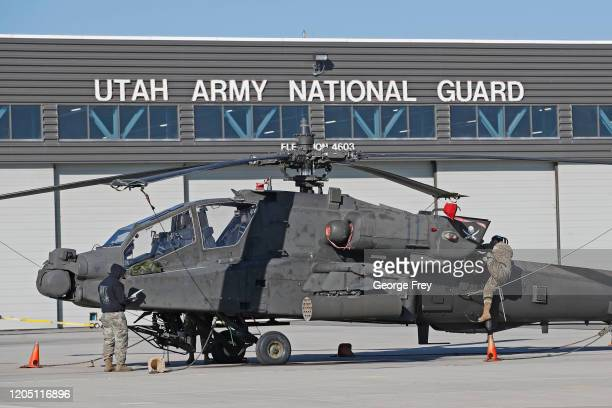 Maintenance workers inspects an AH-64 Apache helicopter on March 4, 2020 in Kearns, Utah. This Utah National Guard facility repairs and performs...
