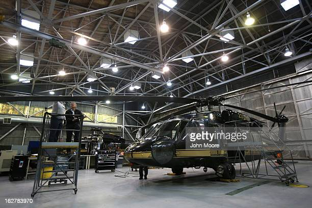 Maintenance workers prepare a blackhawk helicopter from the US Office of Air and Marine on February 26 2013 in Tucson Arizona The OAM a US Customs...