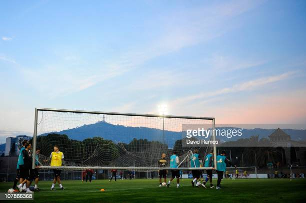 Mainz 05 player carry a goal with 'La Masia' on the background during a training camp session at Camp Nou on January 4 2011 in Barcelona Spain