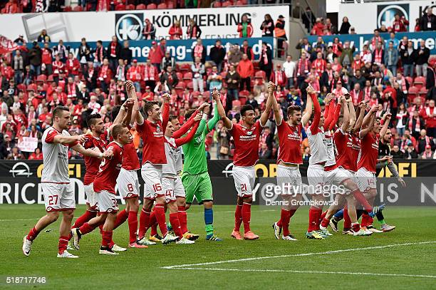 Mainz 05 players celebrate after their 42 victory in the Bundesliga match between 1 FSV Mainz 05 and FC Augsburg at Coface Arena on April 2 2016 in...