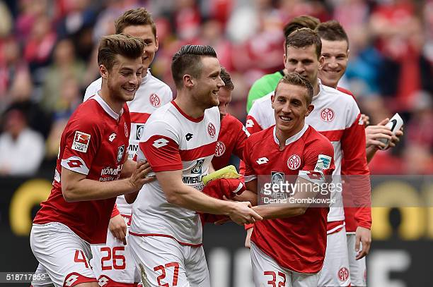 Mainz 05 players Christian Clemens and Pablo De Blasis celebrate after their 42 victory in the Bundesliga match between 1 FSV Mainz 05 and FC...