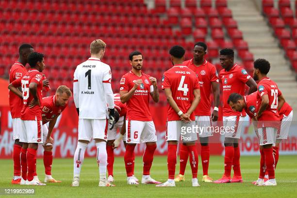 Mainz 05 players huddle before the kick off during the Bundesliga match between 1. FSV Mainz 05 and FC Augsburg at Opel Arena on June 14, 2020 in...