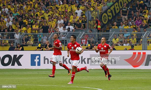 Mainz 05's celebrate scoring a goal during their Bundesliga soccer match between Borussia Dortmund and FSV Mainz 05 at the SignalIduna stadium in...