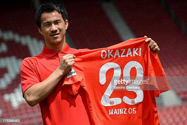 Mainz 05's new player Shinji Okazaki poses during his official presentation at Coface Arena on July 13, 2013 in Mainz, Germany.