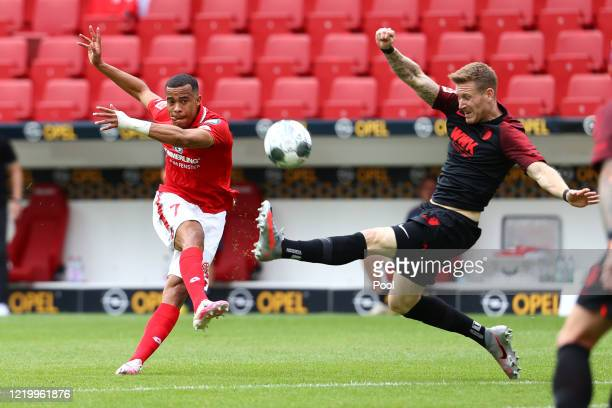 Mainz 05's Robin Quaison shoots during the Bundesliga match between 1. FSV Mainz 05 and FC Augsburg at Opel Arena on June 14, 2020 in Mainz, Germany.