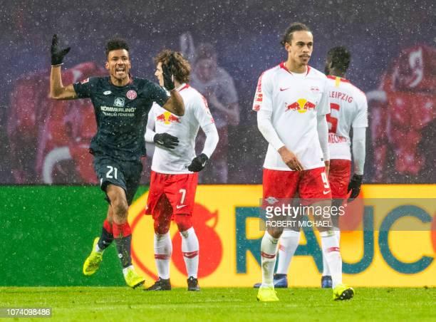 Mainz´ Austrian midfielder Karim Onisiwo celebrates scoring during the German first division Bundesliga football match between RB Leipzig and FSV...