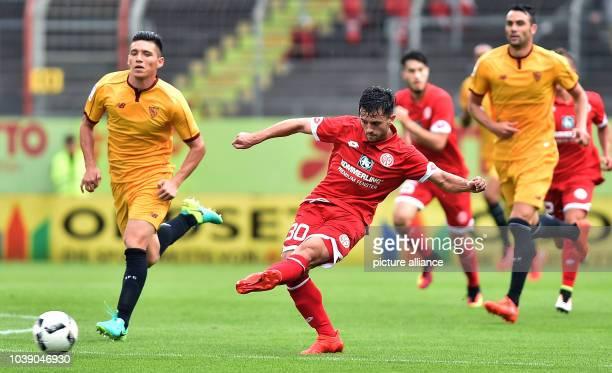 Mainz' Besar Halimi in action against Sevilla's Claudio Matias Kranevitter during the international soccer friendly match between FSV Mainz 05 and...