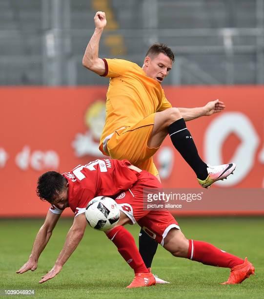 Mainz' Besar Halimi in action against Sevilla's Vincente Iborra during the international soccer friendly match between FSV Mainz 05 and Sevilla FC in...