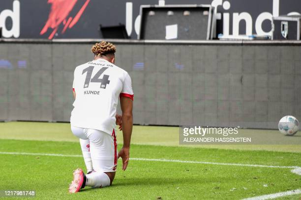Mainz' Cameroonian midfielder Kunde Malong takes a knee in solidarity with protests raging across the United States over the death of George Floyd,...