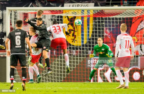 Mainz' Danish forward Emil Berggreen scores the second goal for his team during the German first division Bundesliga football match between RB...