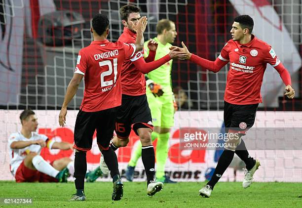 Mainz' defender Stefan Bell celebrates with teammates after scoring during the German first division Bundesliga football match between RB Leipzig and...