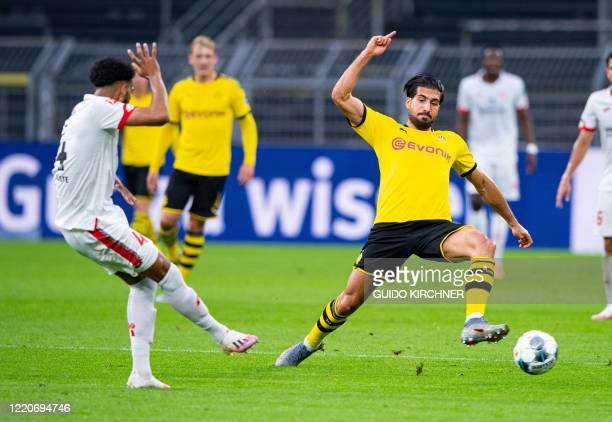 Mainz' Dutch defender Jeremiah St Juste and Dortmund's German midfielder Emre Can vie for the ball during the German first division Bundesliga...