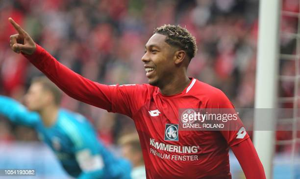 Mainz' Dutch forward JeanPaul Boetius celebrates scoring the 11 during the German first division Bundesliga football match FSV Mainz 05 vs FC Bayern...
