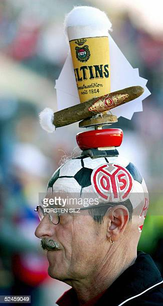 Mainz fan wearing a beer and cigar headpiece, celebrates his teams 100th anniversary prior to the Mainz vs Schalke 04 Bundesliga match in Mainz 20...