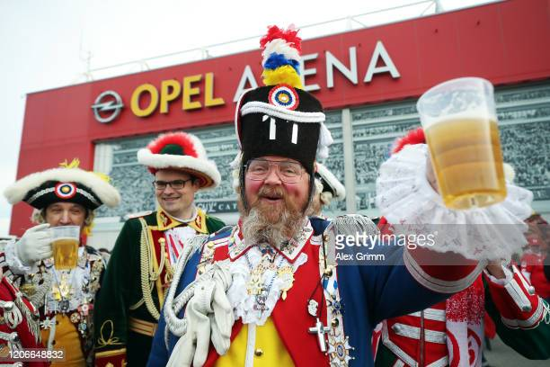 Mainz fans are dressed up for Carnival prior to the Bundesliga match between 1. FSV Mainz 05 and FC Schalke 04 at Opel Arena on February 16, 2020 in...