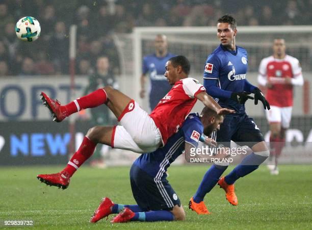 Mainz' French defender Abdou Diallo and Schalke's Austrian forward Guido Burgstaller vie with the ball during the German first division Bundesliga...