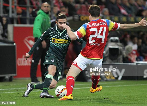 Mainz' French defender Gaetan Bussmann and Moenchengladbach's midfielder Julian Korb vie for the ball during the German first division Bundesliga...