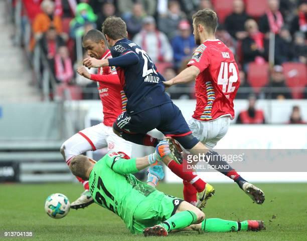 Mainz' German defender Alexander Hack German defender Alexander Hack and German goalkeeper Robin Zentner vie with Bayern Munich's German forward...