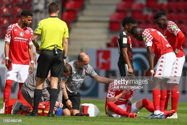 Mainz' German forward Jonathan Burkardt receives medical attention during the German first division Bundesliga football match Mainz 05 vs FC Bayern...