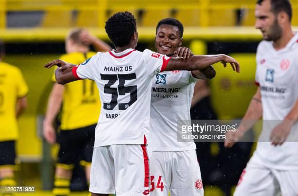 Mainz' German midfielder Ridle Baku celebrates with Mainz' Luxembourgian midfielder Leandro Barreiro Martins after the German first division...