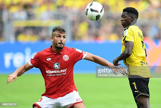 Mainz' Italian defender Giulio Donati and Dortmund's French midfielder Ousmane Dembele vie for the ball during the German first division Bundesliga...