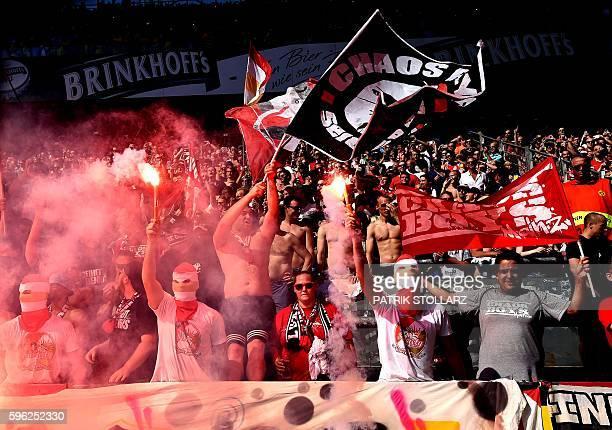 Mainz' supporters light flares during the German first division Bundesliga football match of Borussia Dortmund vs FSV Mainz 05 in Dortmund western...