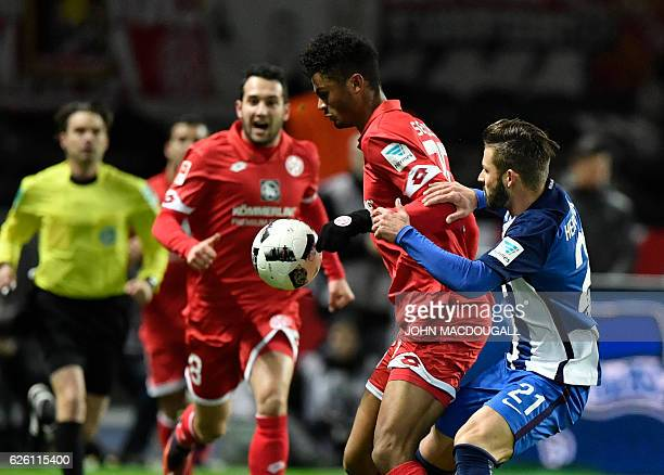 Mainz's Aaron Seydel and Berlin's defender Marvin Plattenhardt vie for the ball during the German first division Bundesliga football match between...