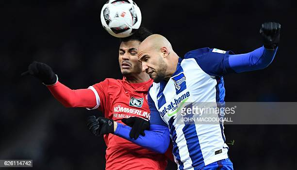 Mainz's Aaron Seydel and Berlin's US defender John Anthony Brooks vie for the ball during the German first division Bundesliga football match between...