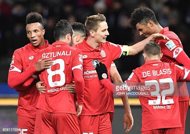Mainz's Aaron Seydel celebrates scoring the opening goal with teammates during the German first division Bundesliga football match between Hertha BSC...