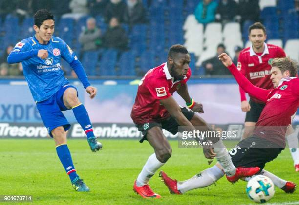Mainz's Japan international forward Yoshinori Muto scores a goal in the first half of his side's 32 defeat by Hanover on Jan 13 2018 ==Kyodo