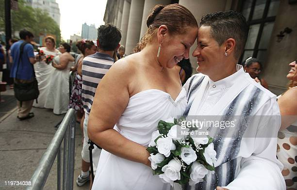 Maira Garcia and Maria Vargas wait on line to get married at the Brooklyn City Clerk's office on July 24 2011 in New York City Today was the first...