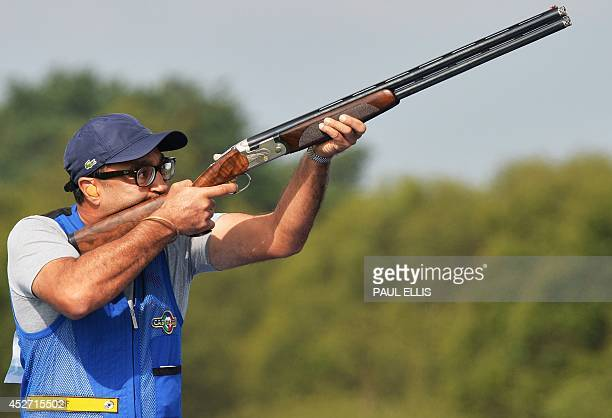 Mairaj Ahmad Kan of India takes part in the Skeet Qualification at the Barry Buddon Shooting Centre in Carnoustie Scotland on July 26 2014 during the...